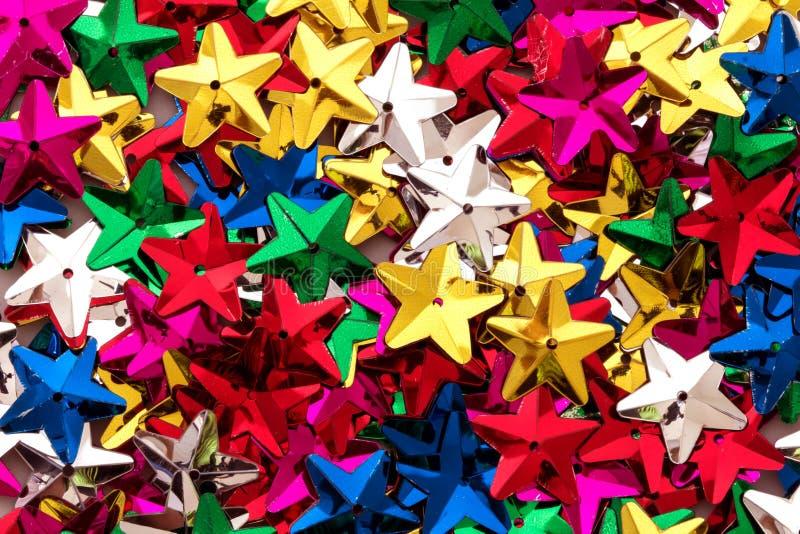 Gli zecchini variopinti brillanti della stella modellano come festivo fanno festa la struttura b fotografia stock libera da diritti
