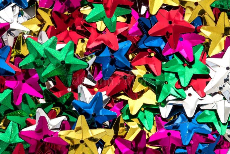 Gli zecchini variopinti brillanti della stella modellano come festivo fanno festa la struttura b fotografie stock libere da diritti