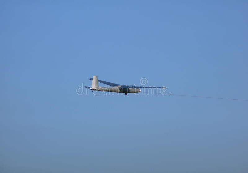 Glider connected to a rope. Photo of a glider connected to a rope royalty free stock photos
