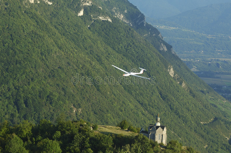 A glider flying over St Michel Church. At Challes les eaux France royalty free stock photos