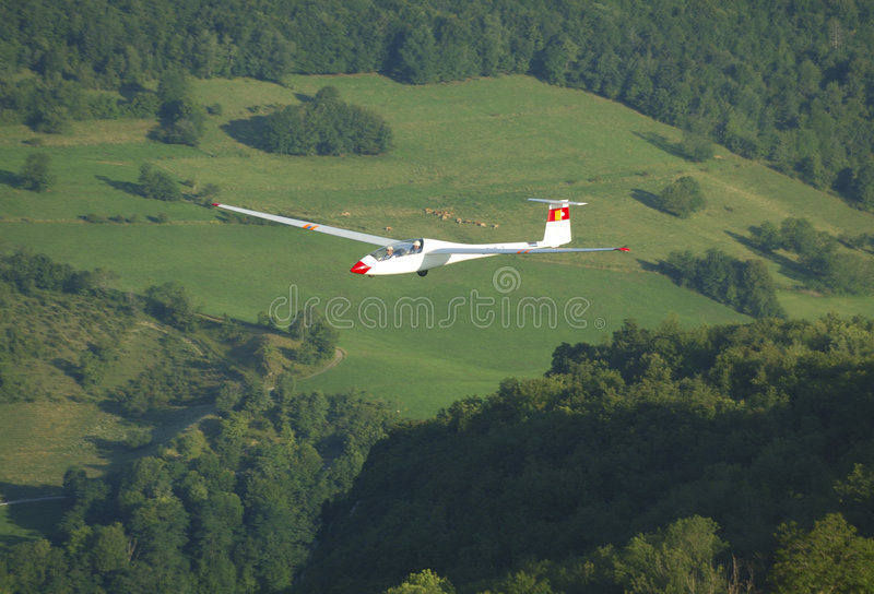 A glider Janus flying over Challes les eaux. A glider Janus A flying over Alps Mountains at Challes les eaux France royalty free stock photography