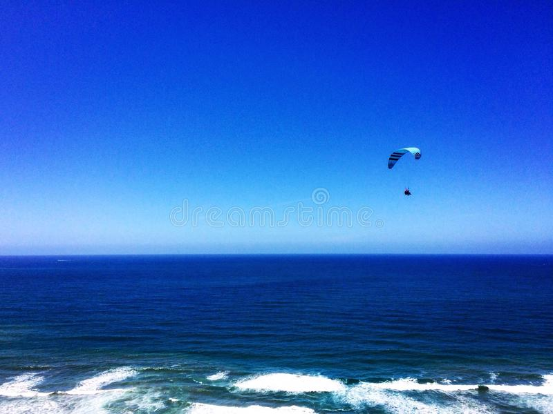 Glider on pacific ocean stock images