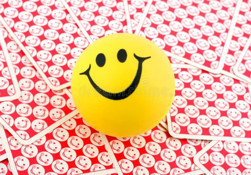 Glimlach in het glimlachen van kaarten royalty-vrije stock afbeeldingen