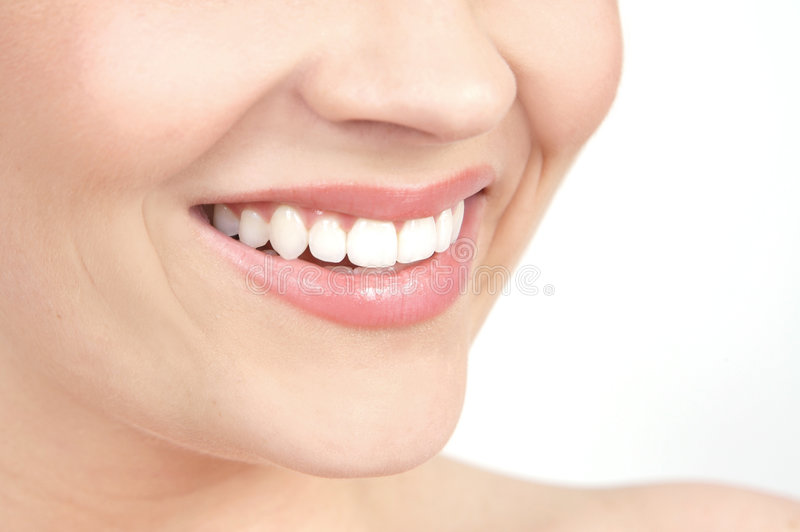 Glimlach van een mooie jonge vrouw stock afbeeldingen