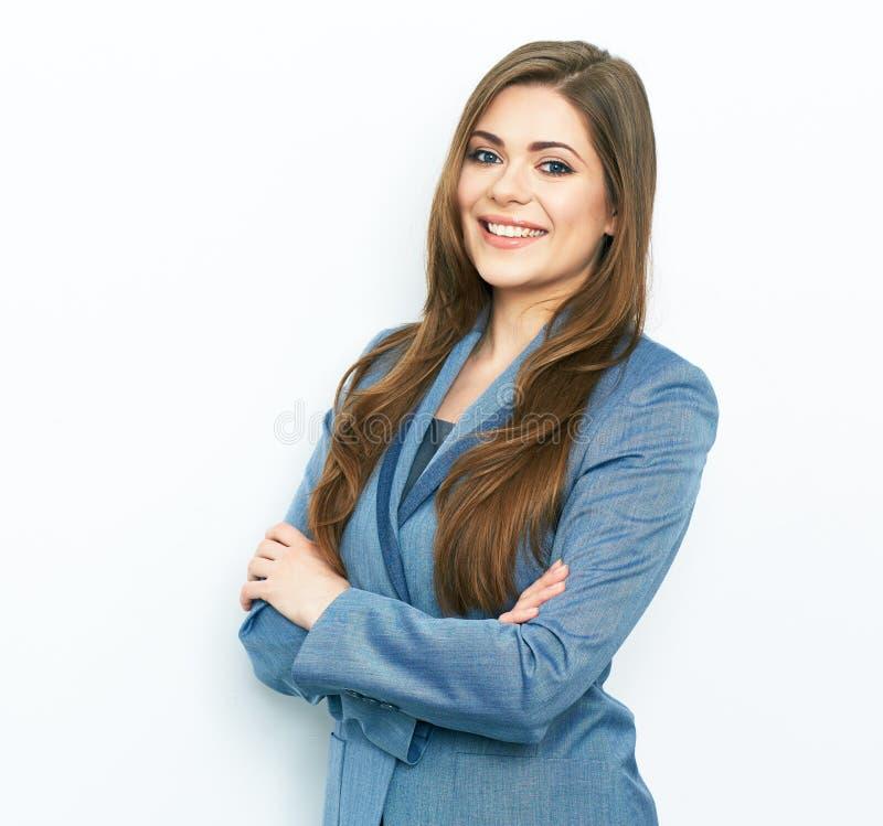 Glimlachend bedrijfsvrouwen blauw kostuum gekleed status tegen wit stock fotografie