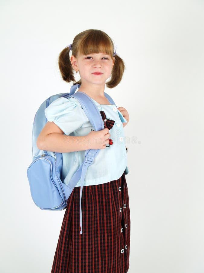 Glimlachend jong schoolmeisje stock afbeelding