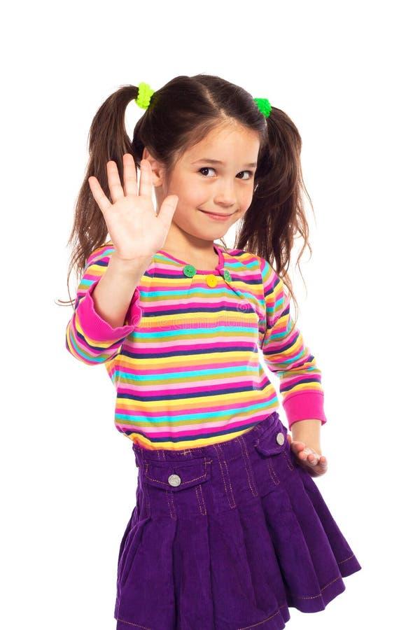 Glimlachend meisje dat haar hand toont royalty-vrije stock afbeelding
