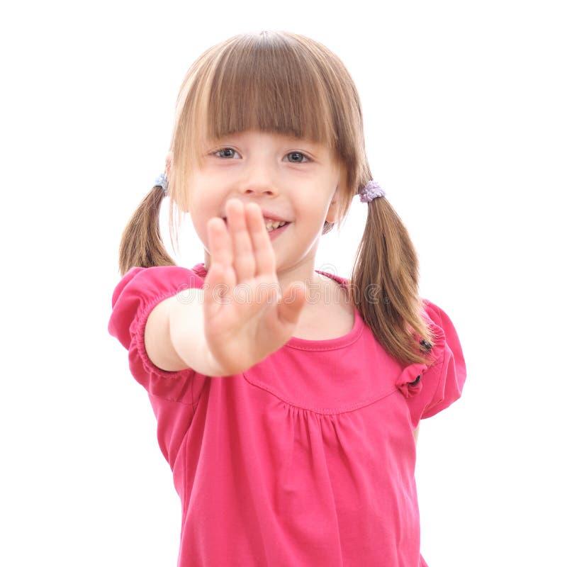 Glimlachend meisje die haar hand tonen royalty-vrije stock foto's