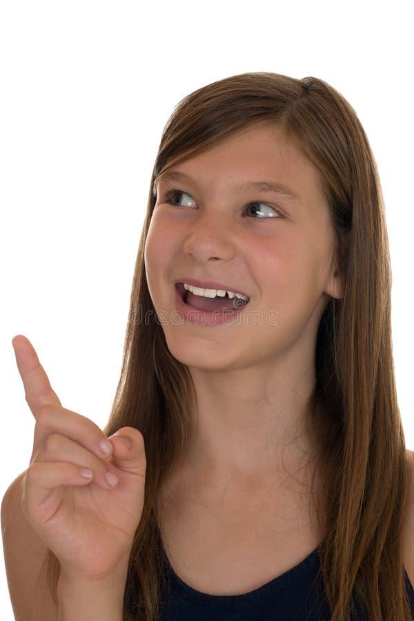 Glimlachend meisje die met haar vinger richten stock fotografie