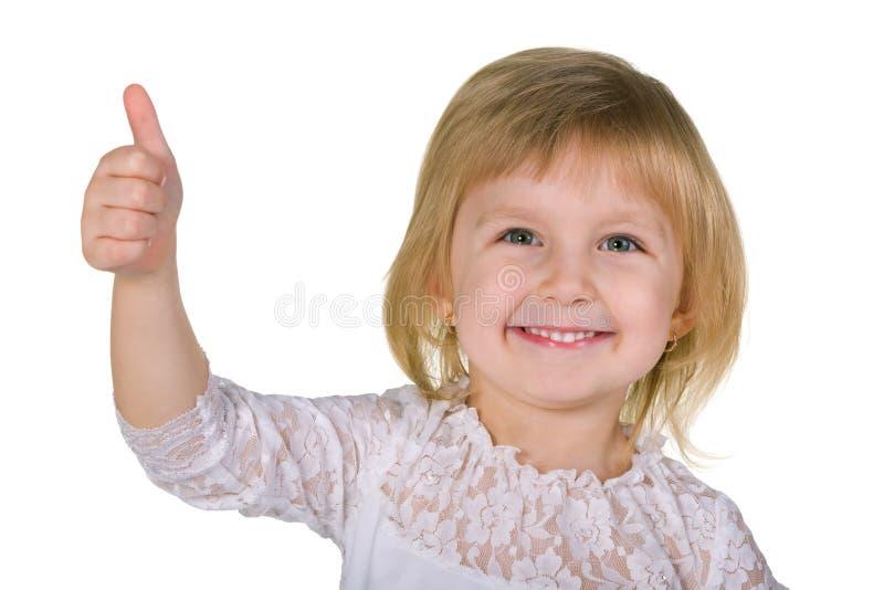 Glimlachend meisje met haar omhoog duim royalty-vrije stock foto's