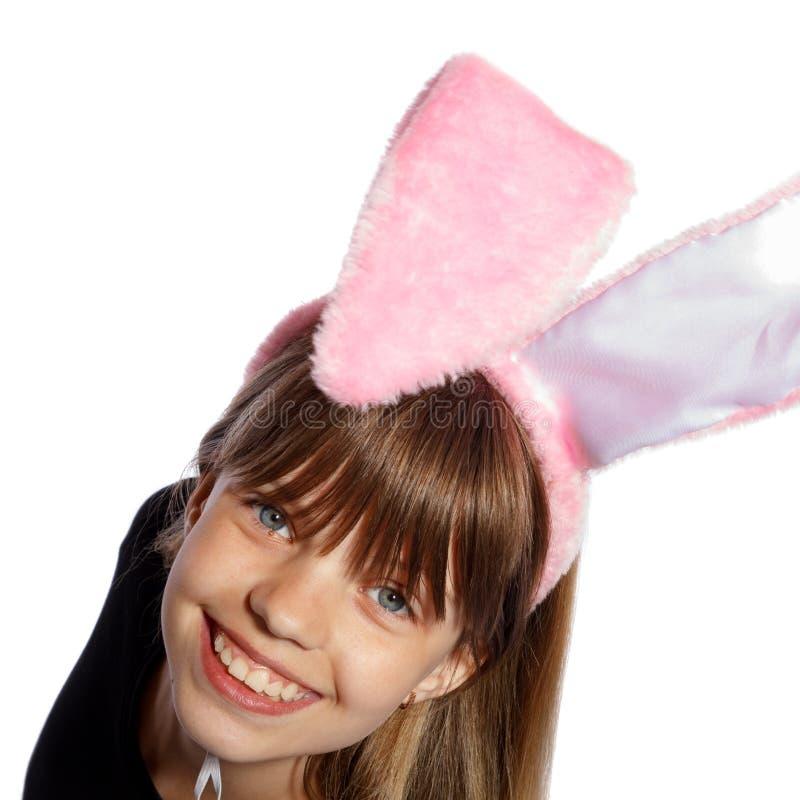 Glimlachend meisje met konijntjesoren stock fotografie