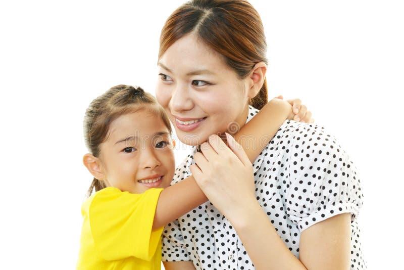 Glimlachend moeder en kind stock foto's