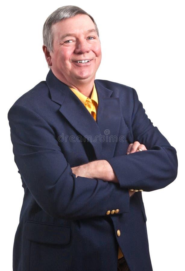 Glimlachend, rijpe zakenman met gevouwen wapens royalty-vrije stock fotografie