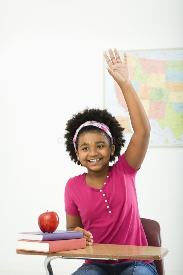 Glimlachend schoolmeisje. royalty-vrije stock afbeeldingen