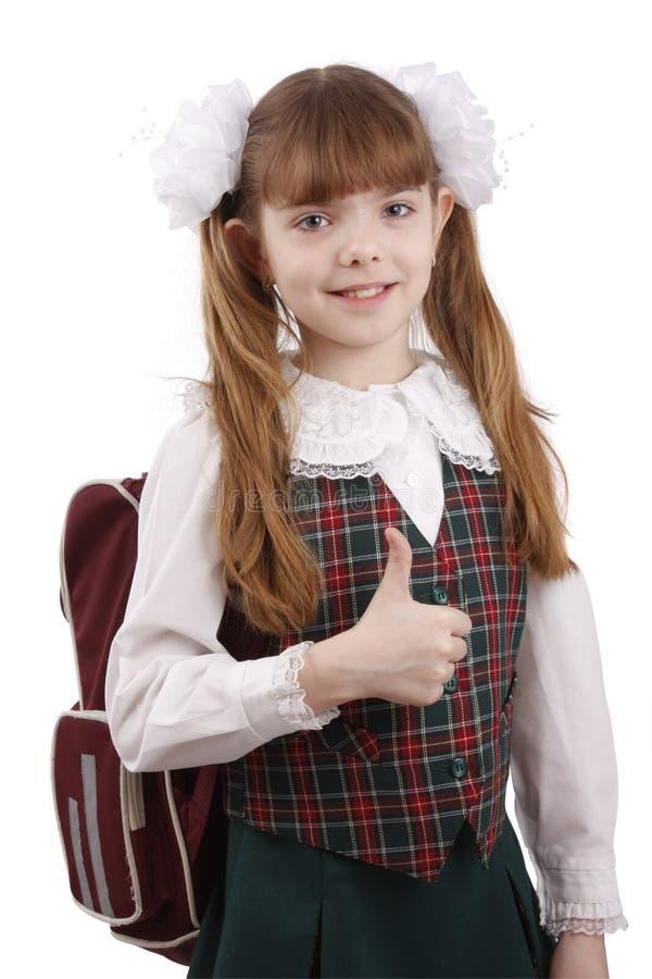 Glimlachend schoolmeisje. Onderwijs. O.K. teken. royalty-vrije stock fotografie