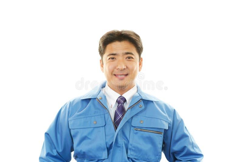 Glimlachende Arbeider royalty-vrije stock afbeeldingen