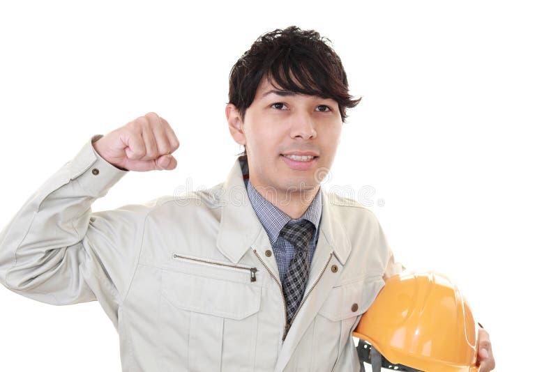 Glimlachende arbeider stock fotografie