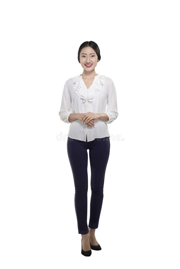 Glimlachende Aziatische bedrijfsvrouw met zekere uitdrukking royalty-vrije stock afbeeldingen