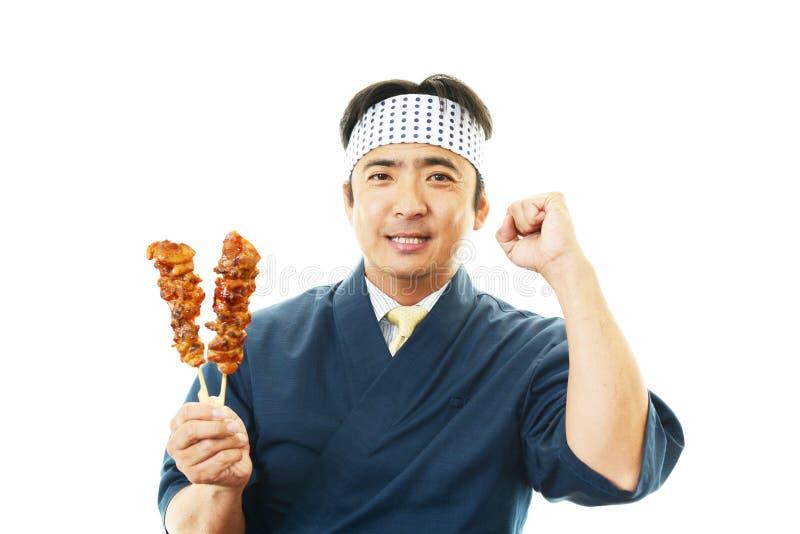 Glimlachende Aziatische chef-kok stock afbeelding