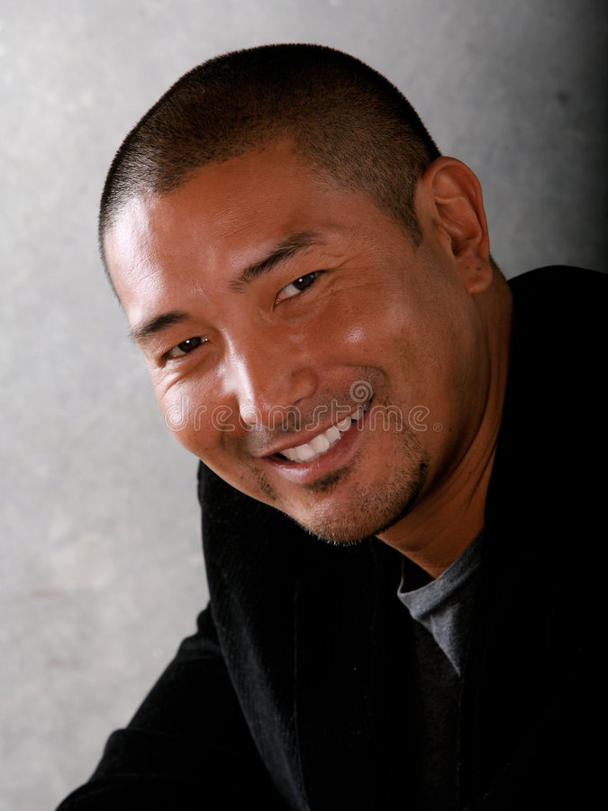 Glimlachende Aziatische Mens royalty-vrije stock afbeelding