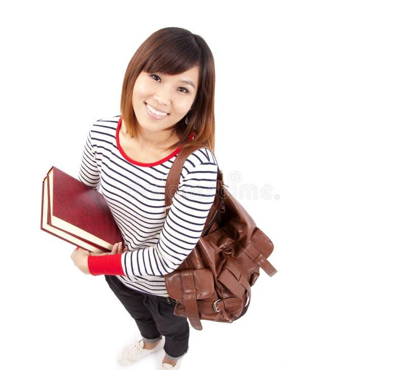 Glimlachende Aziatische student stock foto's