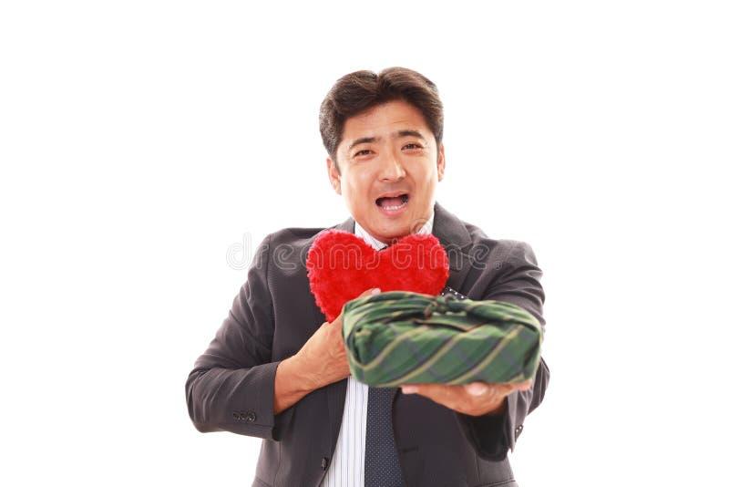 Glimlachende Aziatische zakenman stock foto