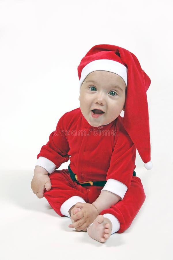 Glimlachende baby in het kostuum van Kerstmis stock foto's