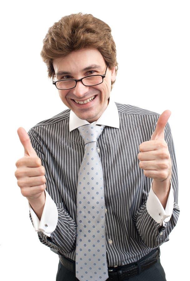 Glimlachende bedrijfsmens met duimen op gebaar royalty-vrije stock foto's