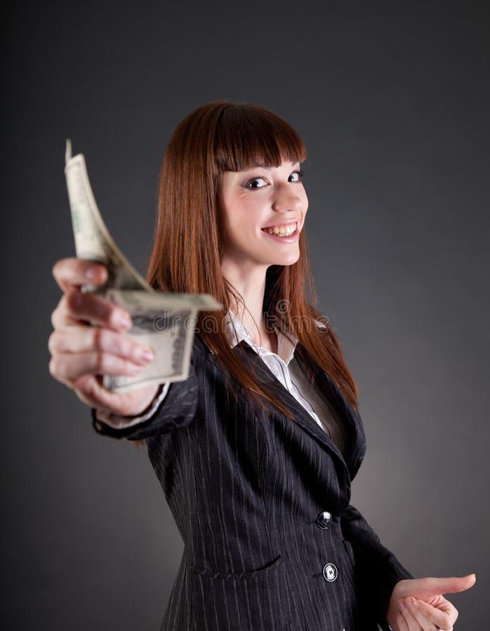 Glimlachende bedrijfsvrouw met dollars royalty-vrije stock afbeelding