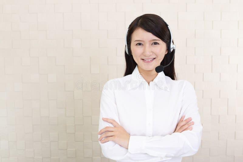 Glimlachende call centreexploitant royalty-vrije stock foto