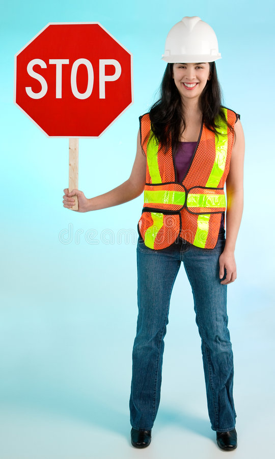 Glimlachende Dame Worker Stopping u voor Som stock foto