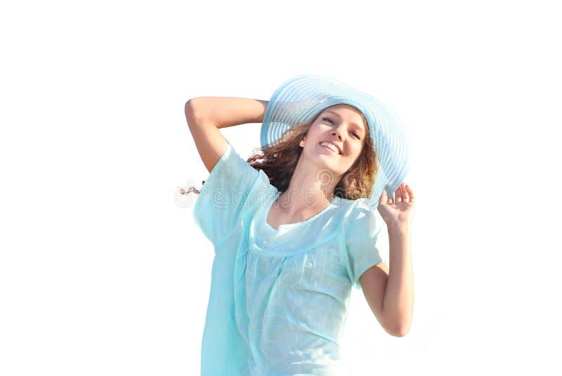 Glimlachende die vrouw over witte achtergrond wordt geïsoleerd stock foto's