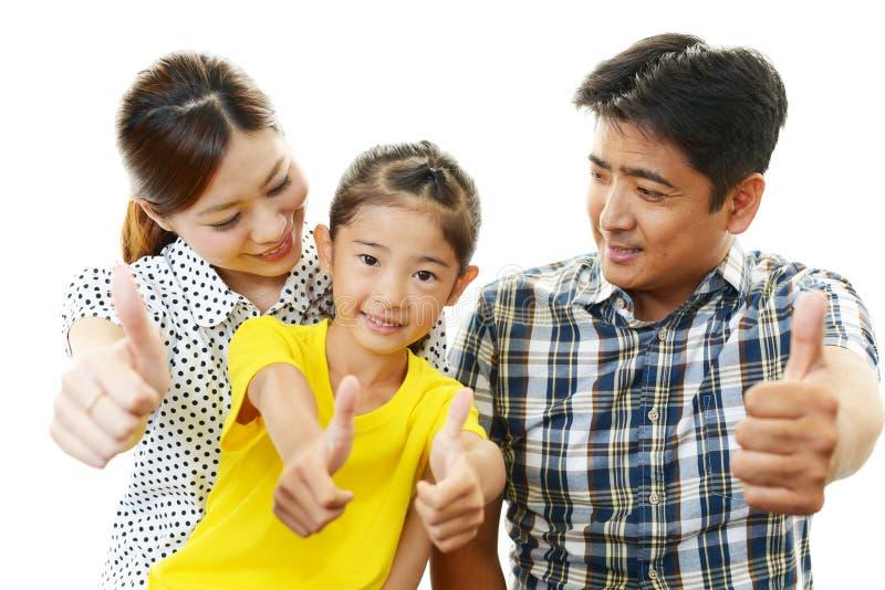 Glimlachende Familie stock afbeelding