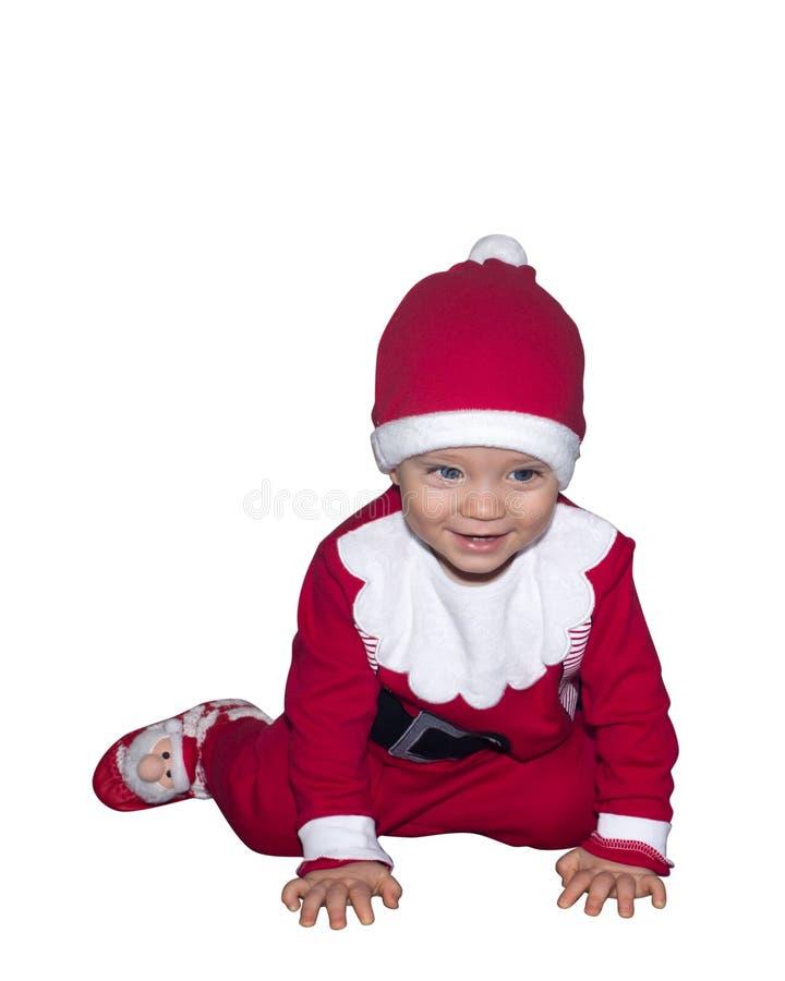 Glimlachende geïsoleerde baby in Santa Claus-kleren stock foto's