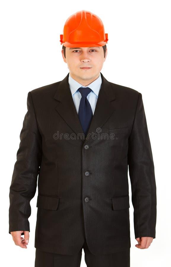 Glimlachende geïsoleerdee zakenman met helm op hoofd royalty-vrije stock afbeeldingen