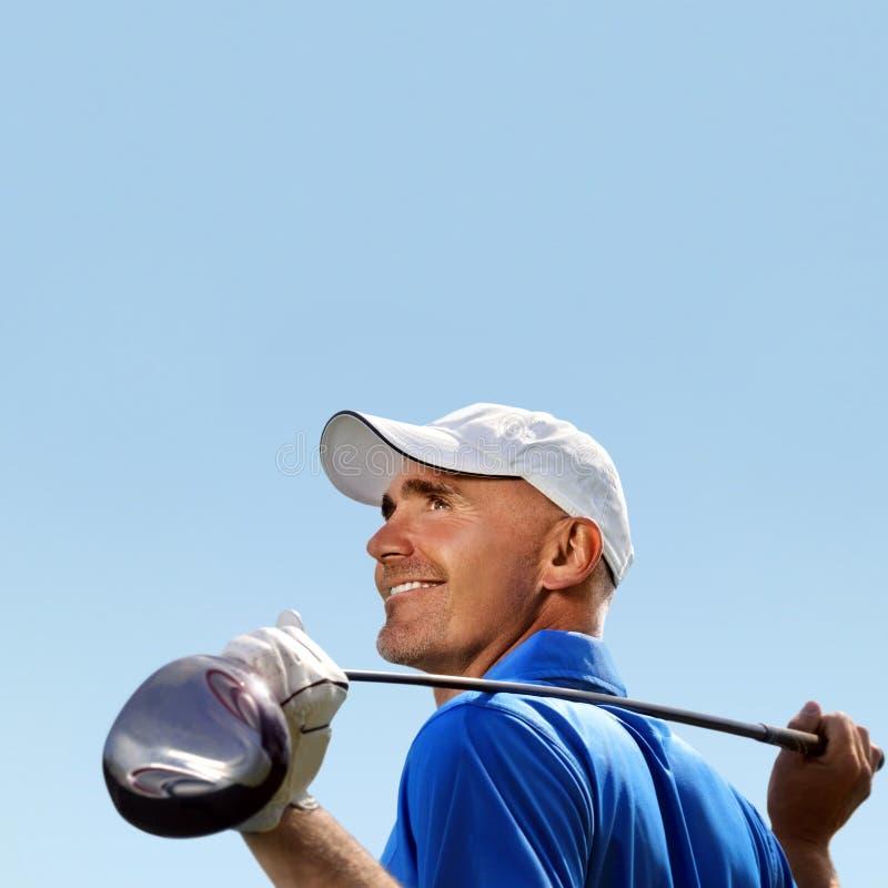 Glimlachende golfspeler stock fotografie