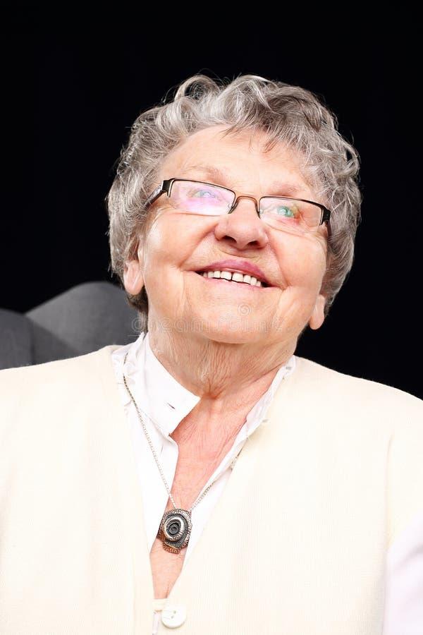 Glimlachende grootmoeder stock afbeeldingen