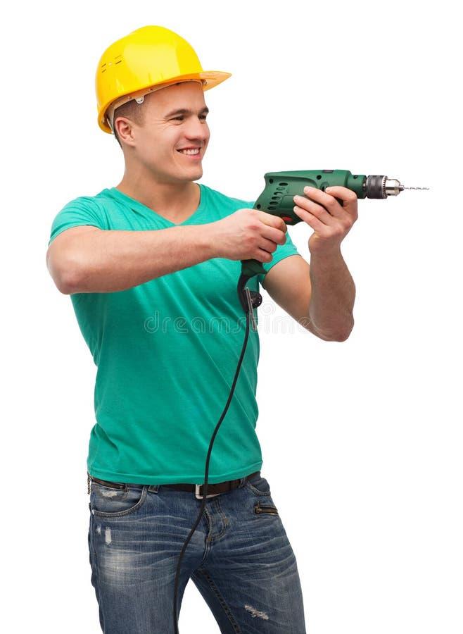 Glimlachende handarbeider in helm met boormachine royalty-vrije stock foto