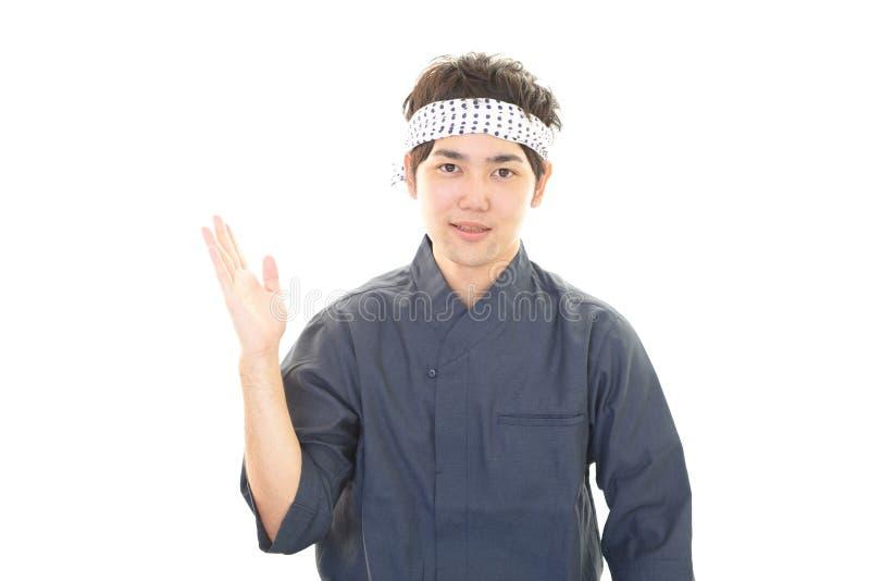 Glimlachende Japanse chef-kok royalty-vrije stock afbeeldingen