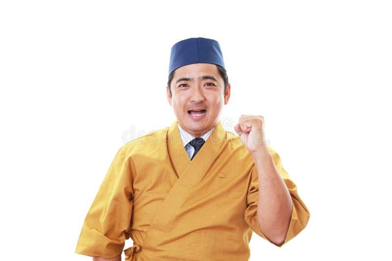 Glimlachende Japanse chef-kok royalty-vrije stock foto's