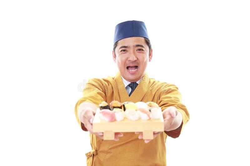 Glimlachende Japanse chef-kok stock foto's