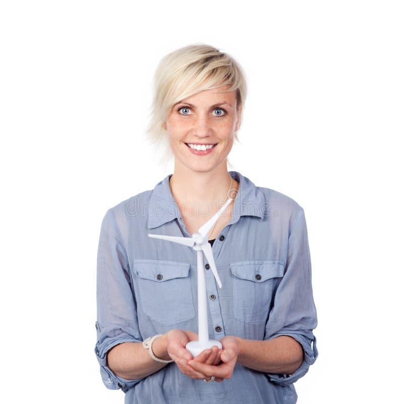 Glimlachende Jonge de Windturbine van de Vrouwenholding stock foto's