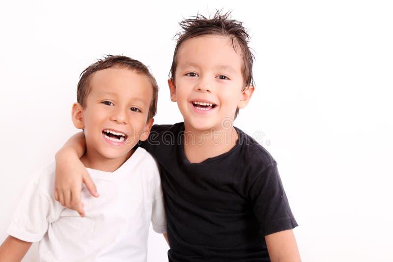 Glimlachende jonge geitjes royalty-vrije stock foto's