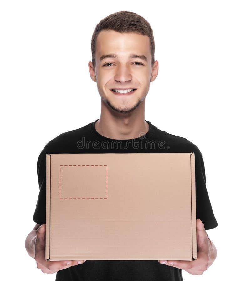 Glimlachende jonge leveringsmens royalty-vrije stock foto