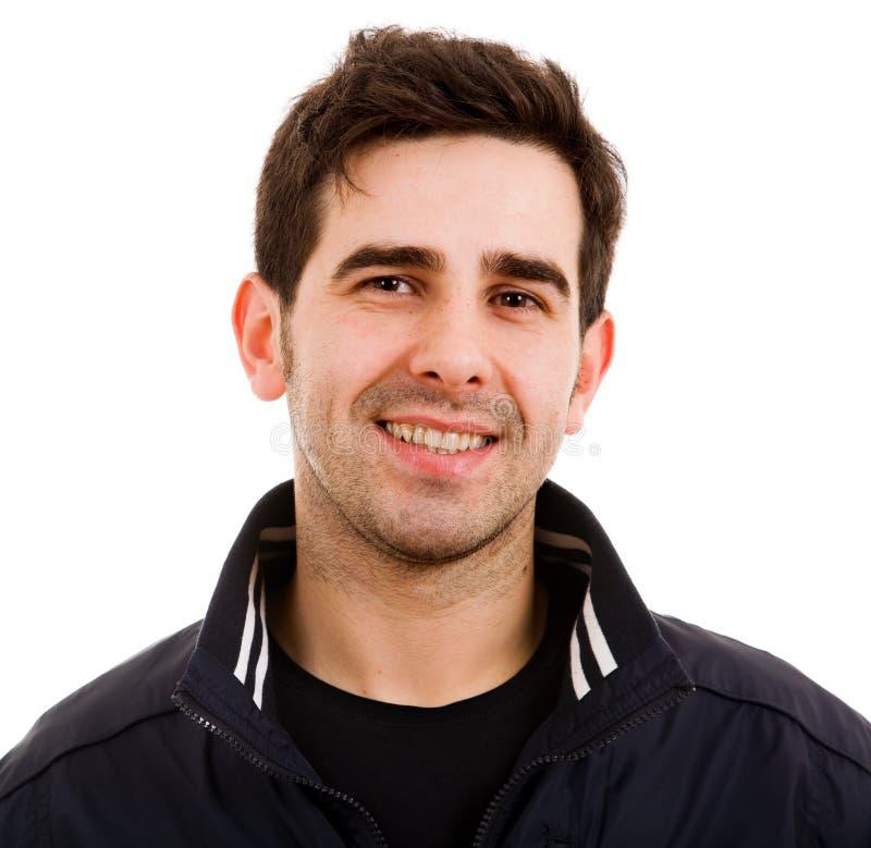 Glimlachende jonge mens stock fotografie