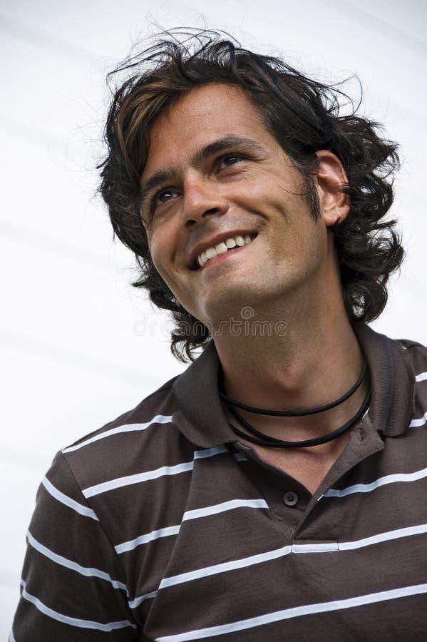 Glimlachende jonge mens royalty-vrije stock foto's
