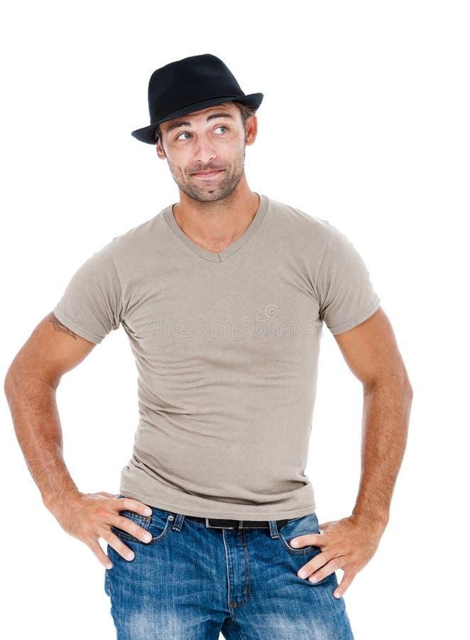 Glimlachende jonge mens met een hoed royalty-vrije stock foto's