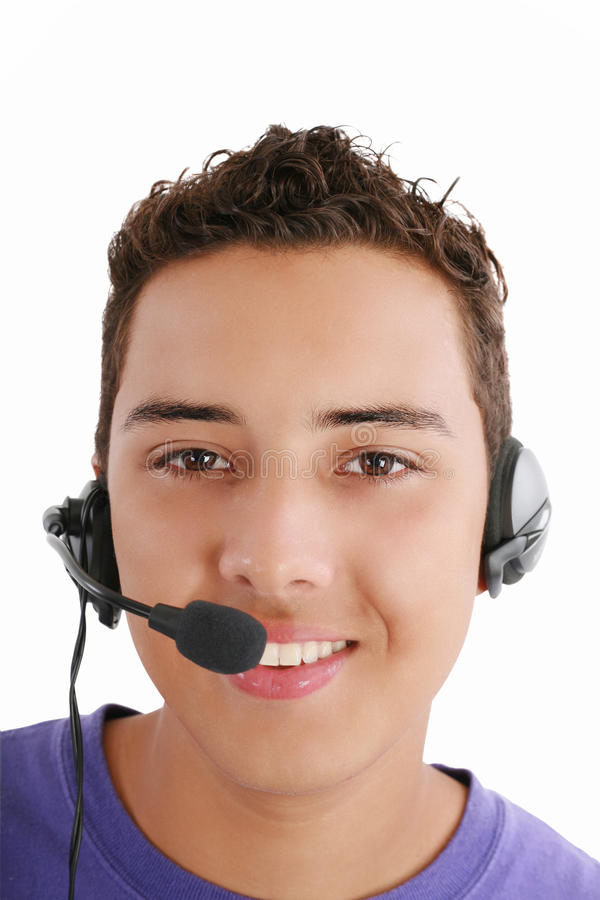 Glimlachende jonge mens met telefoon stock fotografie