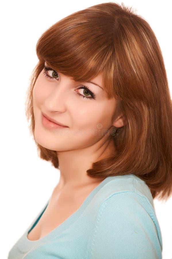 Glimlachende jonge mooie vrouw stock fotografie