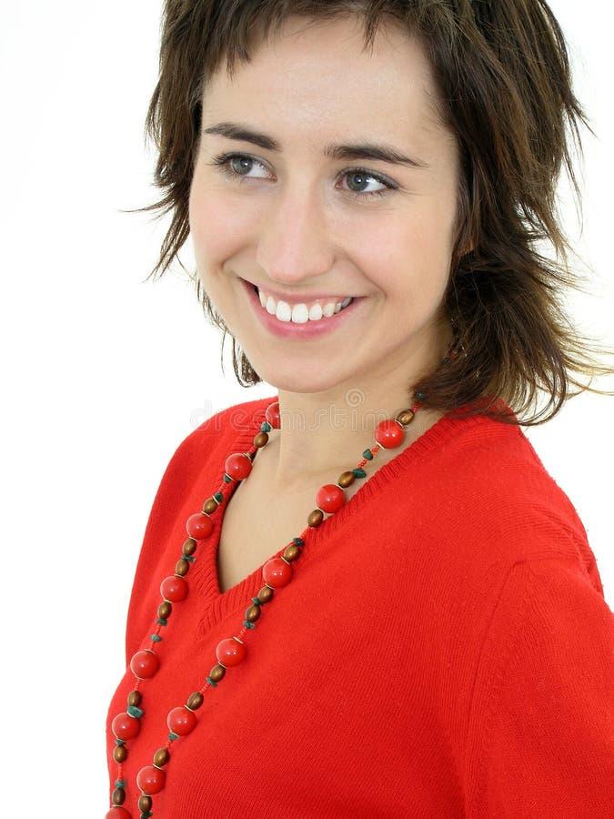 Glimlachende jonge vrouw royalty-vrije stock afbeeldingen